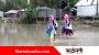 স্কুল খুলেছে বাঁধ ভাঙা আনন্দে ৪ কিলোকাঁদাপানি পেরিয়ে স্কুলে শিক্ষার্থীরা